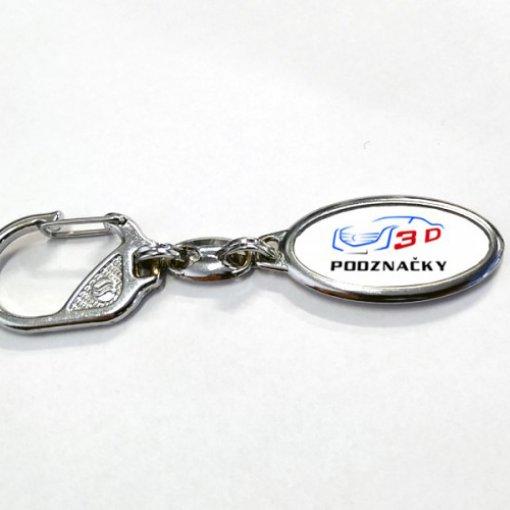 Metalowy brelok z motywem z logo